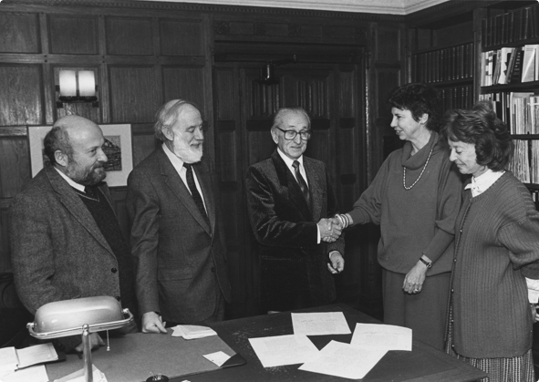 The founders of the Fortunoff Archive shaking hands