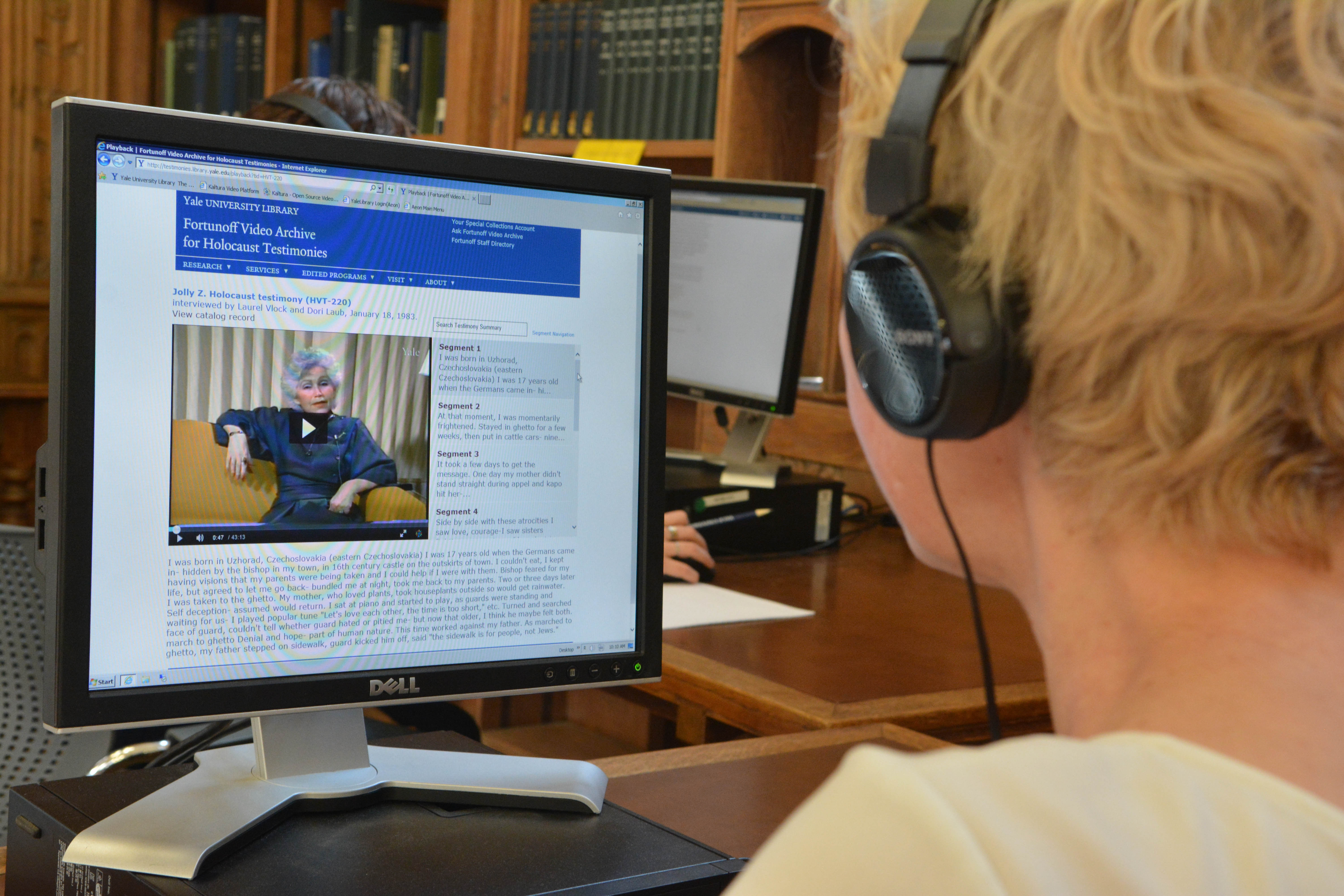 Researcher viewing a testimony in the digital access system