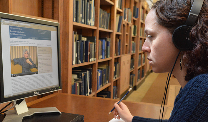A researcher viewing a testimony in the digital access system